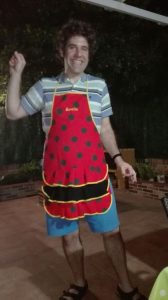 Doer in the customary apron all guests in his Spanish family's home are required to wear