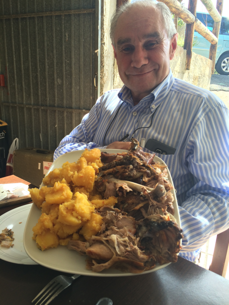 Conchita's husband Cito proudly displaying the lamb and potatoes