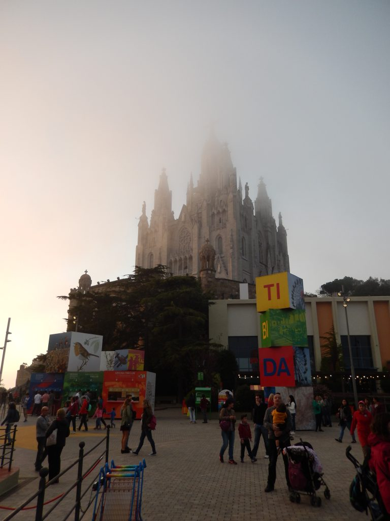 Fog obscuring the top of the cathedral
