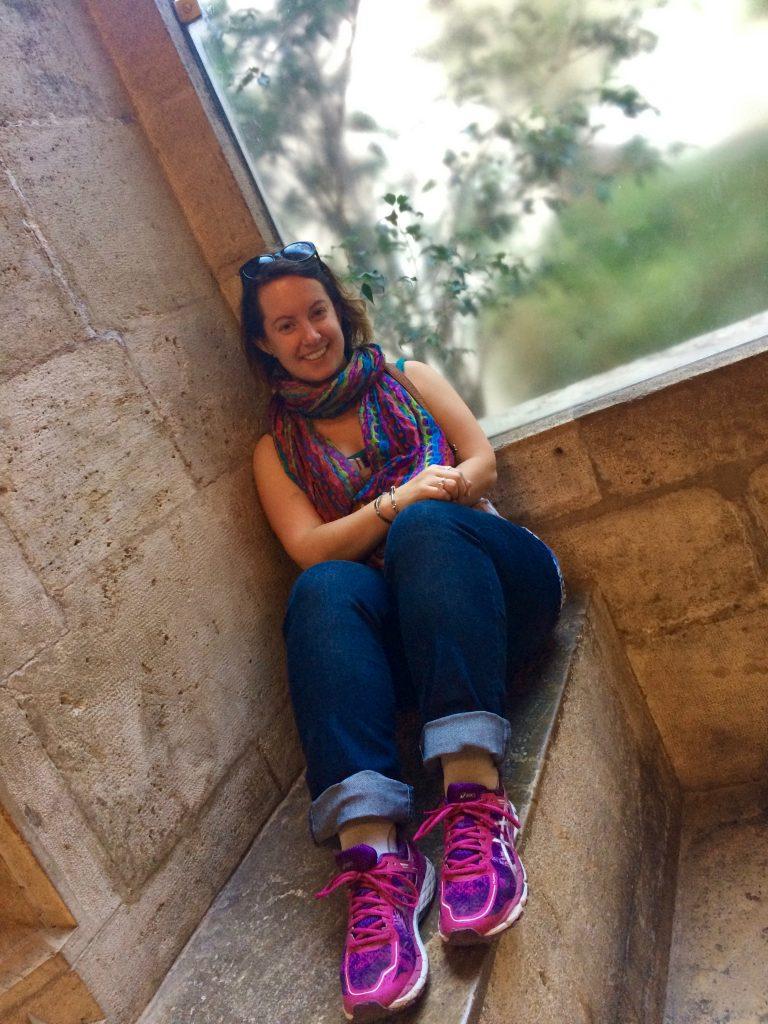 Dreamer posing artfully in a window at La Lonja de la Seda